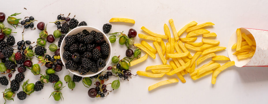 what will you choose? Fresh healthy berries come out from the bowl or junk potato fries from paper box