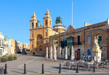 Marsaxlokk. The building of the church of St. Peter on a sunny morning.