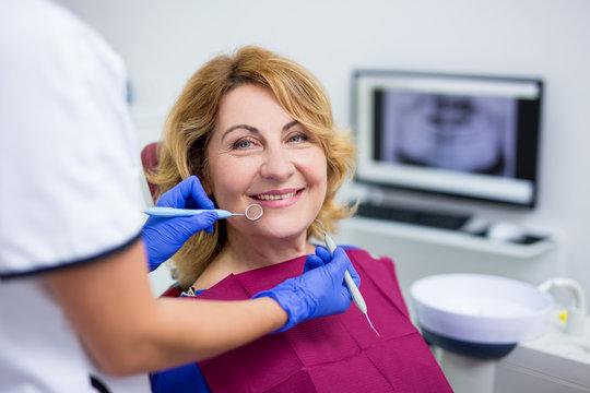 portrait of mature woman patient in dental clinic