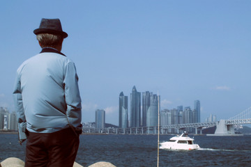 Man looking the bay in Busan, South Korea