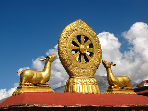 Jokhang temple roof detail of golden dharma wheel and animals, Llasa, Tibet, China, Asia