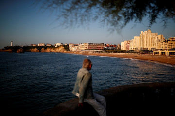 A man enjoys the sunset near the Grande Plage beach ahead of the G7 summit in Biarritz