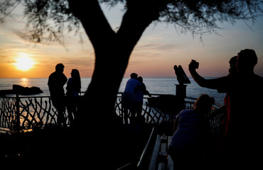 People enjoy the sunset near the Grande Plage beach ahead of the G7 summit in Biarritz