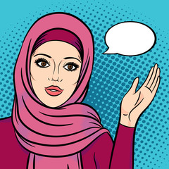 Arabic woman in hijab pointing on speech bubble for your message. Attractive muslim woman smiling face.