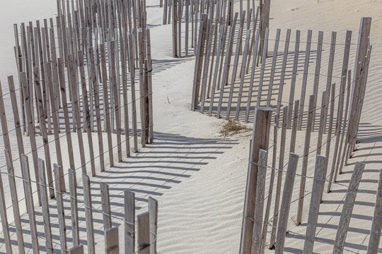 Wooden fence at a windy and sandy beach, Long Beach, New York