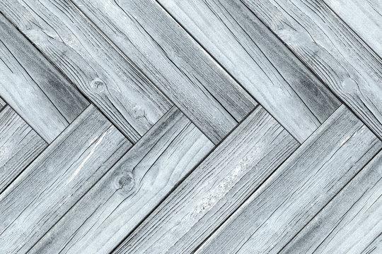 wooden  floor background - herringbone wood closeup  -