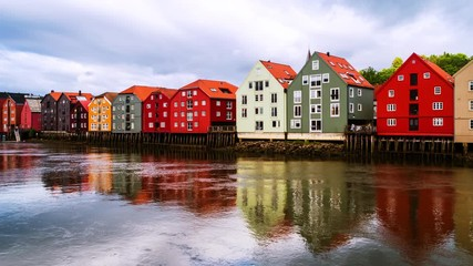 Wall Mural - Trondheim, Norway. City center of Trondheim, Norway during the cloudy summer day. Time-lapse of historical colorful building and grey cloudy sky, zoom