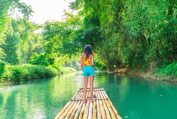 Aluminium Prints Bamboo Woman on bamboo raft, Martha Brae. Tourist boy whilst on cruise on vacation in Montego Bay, Jamaica, Caribbean.