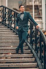 Elegantly dressed gentleman on staircase