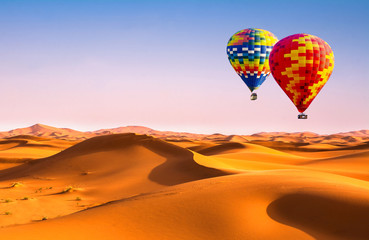 Poster Ballon Travel concept. Amazing view of sand dunes with hot air balloons in the Sahara Desert. Location: Sahara Desert, Morocco. Artistic picture. Beauty world.