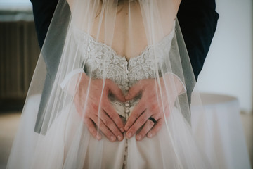 woman in wedding dress and man embracing
