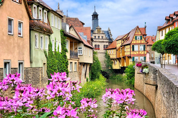 Fototapete - Picturesque old buildings and flowers lining a canal in the town of Marktbreit, Bavaria, Germany