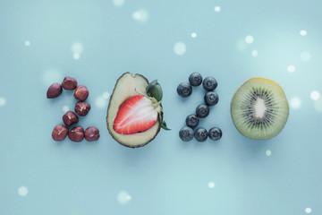 2020 made from healthy food on pastel blue background, Healhty New year resolution diet and lifestyle