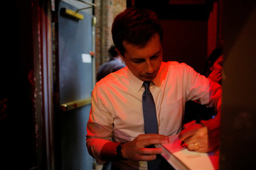 Democratic 2020 U.S. presidential candidate Buttigieg autographs books after a campaign stop in Portland