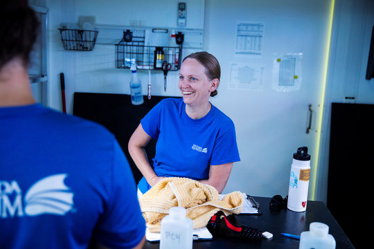 Chief coral scientist Keri O'Neill laughs in an aquarium facility full of Pillar coral (Dendrogyra cylindricus) just a few days before the animals would successfully spawn in an aquarium for the first time at a Florida Aquarium facility in Apollo Beach, Fl