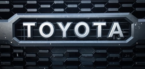 Black Toyota Logo on a Dirty Toyota Tacoma Truck Grill