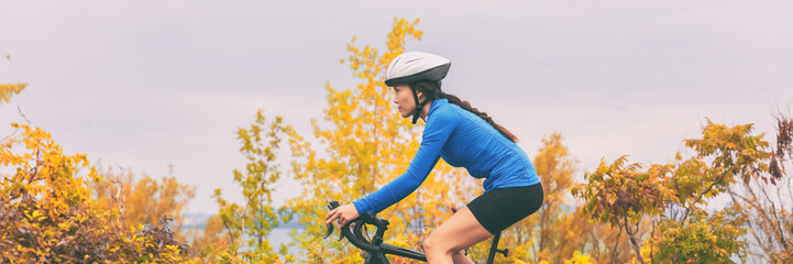 Autumn sport active lifestyle cyclist woman doing bicycle in fall nature forest background ....