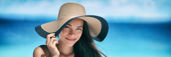 Beach asian woman skin sun protection hat on summer vacation miling tanning banner panorama. Suntan...