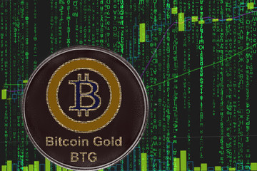 coin BTG bitcoin gold cryptocurrency on the background of binary crypto matrix text and price chart.
