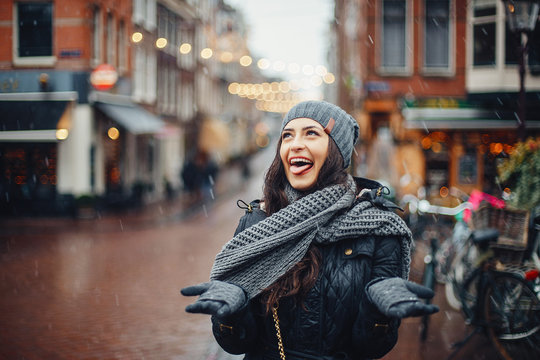 female tourist walking around and exploring Amsterdam Netherlands