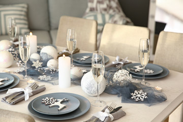 Beautiful table setting with Christmas decorations in living room Wall mural