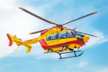 Photo sur Plexiglas Hélicoptère Red and yellow Helicopter of air rescue service Team.