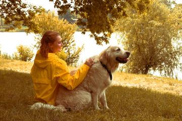 Woman Tenderly Hugging Pet Dog. Autumn colors