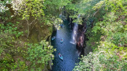 Wall Mural - Takachiho Gorge with boat and travller in Miyazaki, Japan time lapse