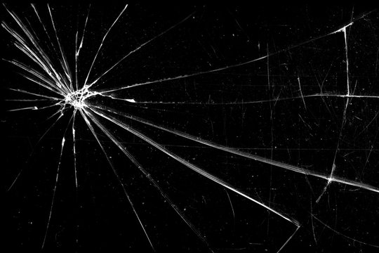 cracked glass isolated on a black background. broken glass