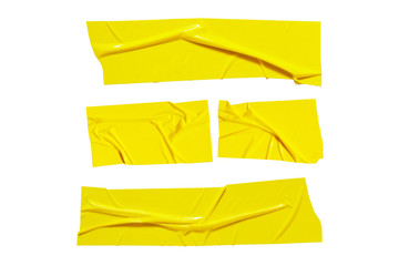 Yellow sticky scotch tapes. Torn crumpled sellotape pieces set isolated on white background