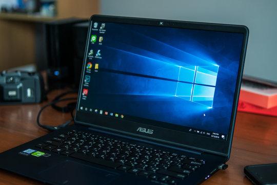 Bangkok, Thailand - August 13, 2018 : Laptop computer showing its screen with Microsoft Windows logo on desktop.
