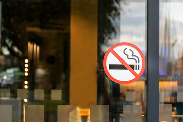 no smoking sticker on the door