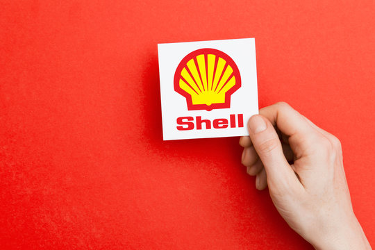 LONDON, UK - October 26th 2018: Hand holding a Shell logo. Shell is an oil and gas producer