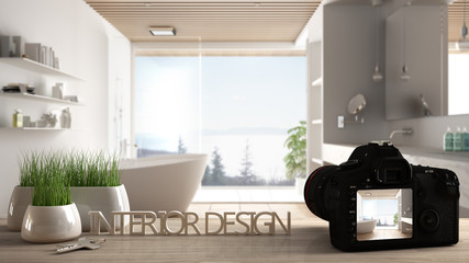 Architect photographer designer desktop concept, camera on wooden work desk with screen showing interior design project, blurred scene in the background, minimalist luxury bathroom