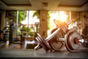 Dumbbells on desk and gym interior