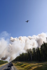 Airplane Flying Over Forest Fire