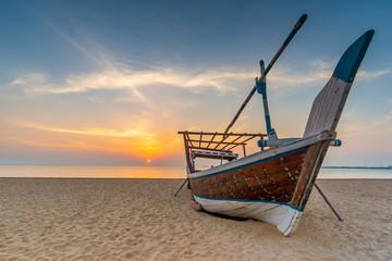 Traditional Arabian boat on a beach, Qatar Wall mural