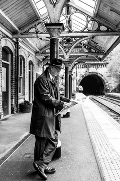 Awaiting his train to York from Knaresborough, the businessman reads his copy of The Yorkshire Post.