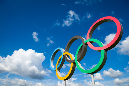 LONDON - APRIL 19, 2019: A large set of Olympic Rings stand under bright blue sky with white clouds.