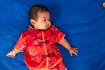 Cute little asian baby boy in Chinese dress