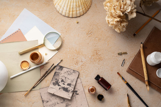Artist's workspace flatlay. Art equipment on rustic background. Top view with copy space.