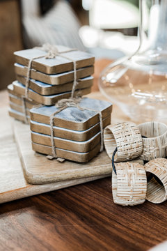 modern gold and marble coasters and woven napkin rings