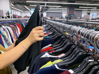 stock retail store of branded clothes with a discount of last year's collection, mobile image
