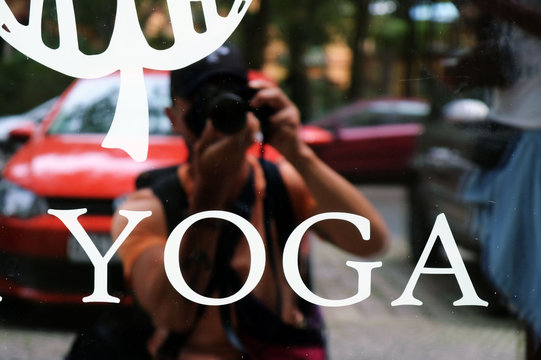 yoga shop window white decal on the street