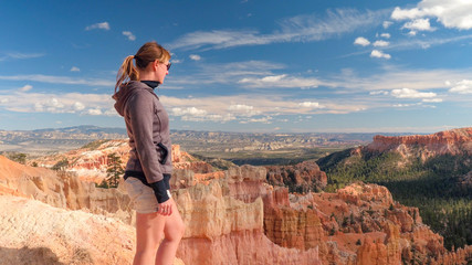 Young traveler admiring stunning landscape view at viewpoint in Bryce Canyon