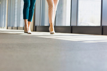 Low section of business people walking on flooring in office Wall mural