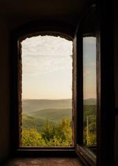 open window on the wall with Italian landscape