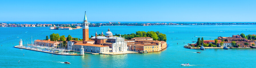 Venice skyline, Italy. San Giorgio Maggiore island in Venetian lagoon. Aerial panoramic view of marine Venice city. Beautiful landscape of Venice in summer. Horizontal banner of Venice in the sea.
