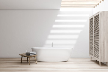 White bathroom with tub and wardrobe