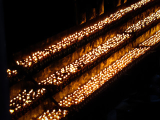 Burning candles in monastery, Tibet, China